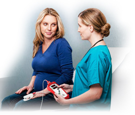 Nurse checking patient with Masimo Pronto